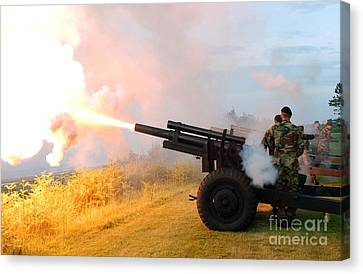 Honor Guard Members Fire A 105 Mm Canvas Print by Stocktrek Images