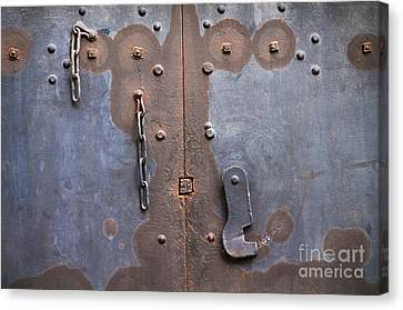 Hooked And Chained Canvas Print by Dan Holm