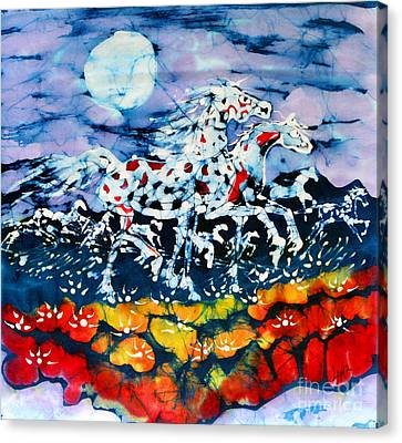 Horses Prance On Flower Field In Summer Moon Canvas Print by Carol Law Conklin