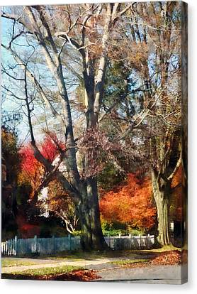 House With Picket Fence In Autumn Canvas Print by Susan Savad