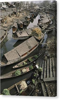 Houseboats Line A Waterway Canvas Print by Gordon Wiltsie