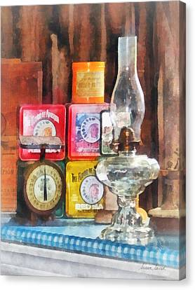 Hurricane Lamp And Scale Canvas Print by Susan Savad