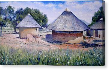 Huts At Pelegano Botswana 2008 Canvas Print by Enver Larney