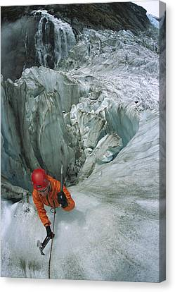Ice Climber On Steep Ice In Fox Glacier Canvas Print by Colin Monteath
