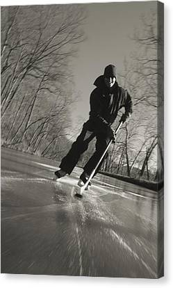 Ice Skater With A Hockey Stick Canvas Print by Skip Brown
