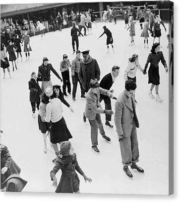 Collier Canvas Print - Ice Skaters At Rockefeller Center by Everett