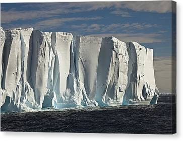 Iceberg Showing Annual Layers Of Snow Canvas Print by Colin Monteath