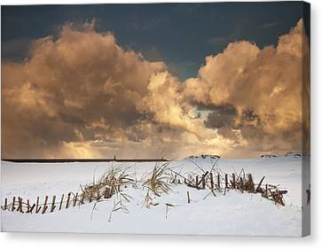 Illuminated Clouds Glowing Above A Canvas Print by John Short