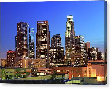 Illuminated Of Downtown Skyscrapers Canvas Print by Kenny Hung Photography