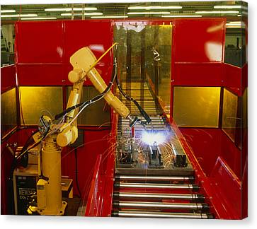 Industrial Robot Welding On Production Line Canvas Print by David Parker600-group