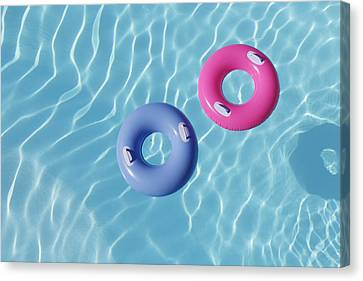 Inflatable Rings In Pool Canvas Print