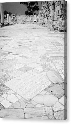 Inscription In The Floor Tile Of The Gymnasium Stoa Ancient Site Salamis Famagusta Canvas Print by Joe Fox