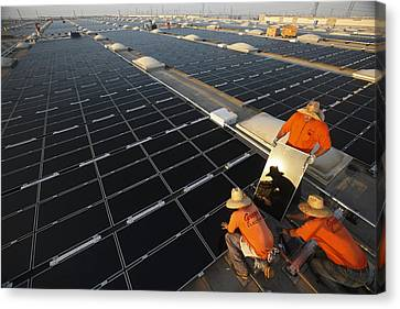 Installing Photovoltaic Panels Canvas Print by Michael Melford