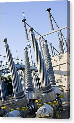 Insulators At Electricity Substation Canvas Print by Mark Williamson