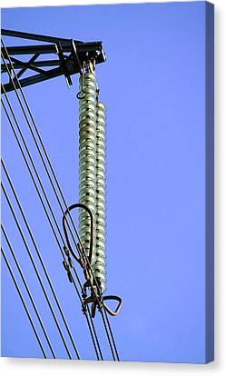 Insulators On An Electricity Pylon Canvas Print by Paul Rapson