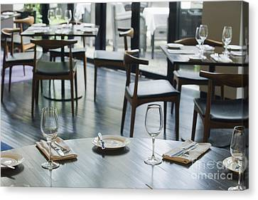 Interior Of Restaurant Canvas Print by Shannon Fagan