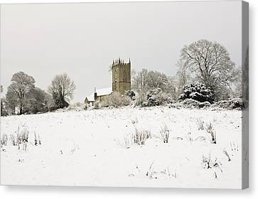 Ireland Winter Landscape With Church Canvas Print by Peter McCabe