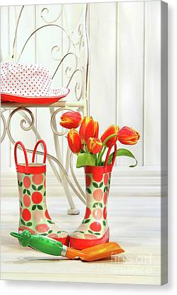 Iron Chair With Little Rain Boots And Tulips  Canvas Print by Sandra Cunningham
