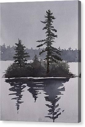 Island Reflecting In A Lake Canvas Print by Debbie Homewood