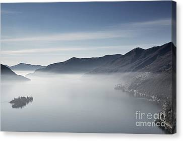 Islands On A Foggy Lake Canvas Print by Mats Silvan