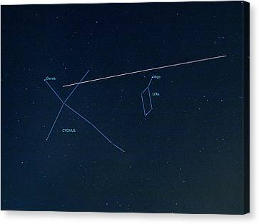 Iss Light Trail And Constellations Canvas Print by Detlev Van Ravenswaay