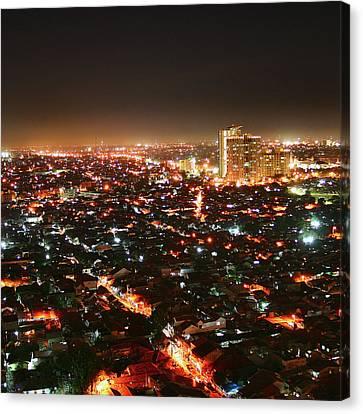 Jakarta At Night Canvas Print by Simonlong