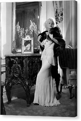 Jean Harlow With Photograph Canvas Print by Everett