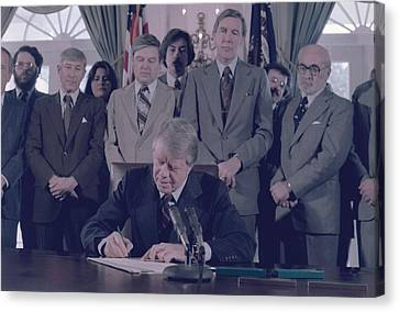 Jimmy Carter Signs The Endangered Canvas Print by Everett
