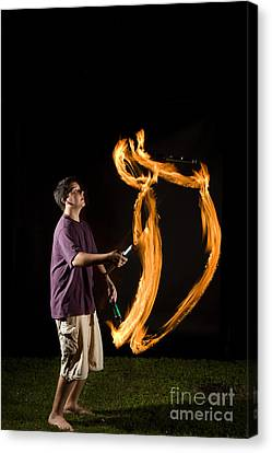 Juggling Fire Canvas Print by Ted Kinsman