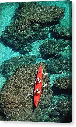 Kayakers In Clear Blue Water Canvas Print by Ralph Lee Hopkins