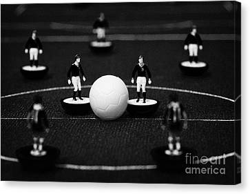 Kick Off Or Restart Football Soccer Scene Reinacted With Subbuteo Table Top Football Players Canvas Print by Joe Fox