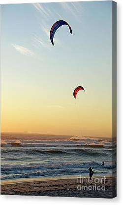 Kite Surfers On Beach At Sunset Canvas Print by Sami Sarkis