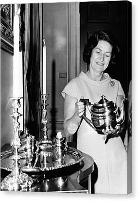 Lady Bird Johnson Holds A Silver Teapot Canvas Print by Everett