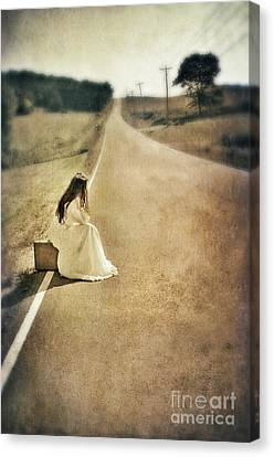 Lady In Gown Sitting By Road On Suitcase Canvas Print by Jill Battaglia