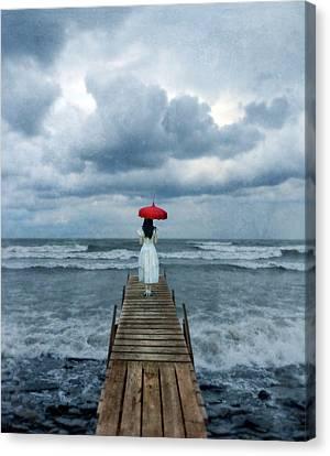 Lady On Dock In Storm Canvas Print by Jill Battaglia