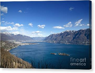 Lake With Islands And Snow-capped Mountain Canvas Print by Mats Silvan