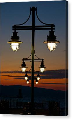 Lamps At Sunset Canvas Print by Mike Horvath