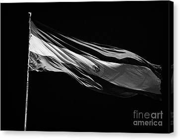 Large Argentinian Flag Flying In The Wind Against A Blue Sky Republic Of Argentina Canvas Print by Joe Fox