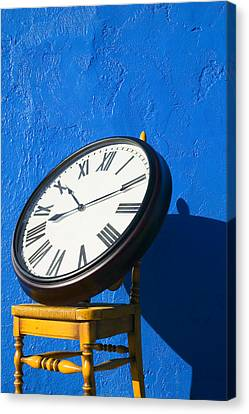 Large Clock On Yellow Chair Canvas Print by Garry Gay