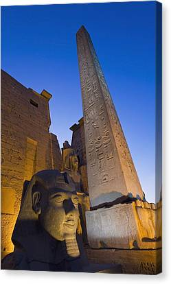 Large Pharaohs Head Statue And Obelisk Canvas Print by Axiom Photographic