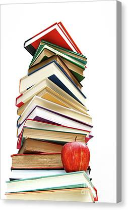 Large Pile Of Books Isolated On White Canvas Print by Sandra Cunningham