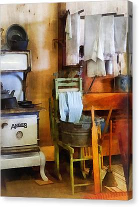 Laundry Drying In Kitchen Canvas Print by Susan Savad
