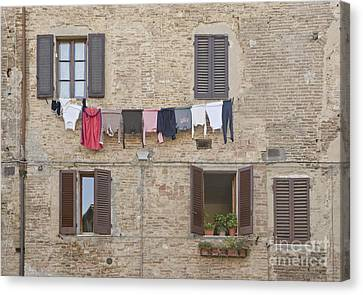 Laundry Out To Dry Canvas Print by Rob Tilley