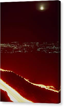 Lava Flow At Night Canvas Print by Dr Juerg Alean