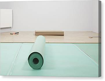 Laying A Floor. A Roll Of Underlay Or Canvas Print