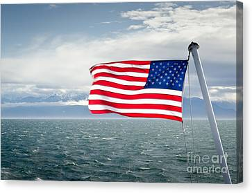 Leaving The Olympics Stars And Stripes On The Straits From The Olympic Mountains Canvas Print by Andy Smy