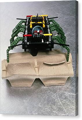 Lego Robot Spider Climbing Over A Box Canvas Print by Volker Steger