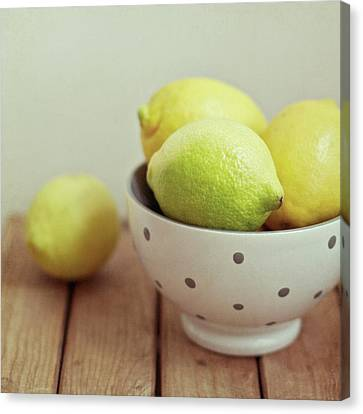 Lemons In Bowl Canvas Print by Copyright Anna Nemoy(Xaomena)