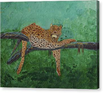 Leopard Laying On A Branch Canvas Print by Swabby Soileau
