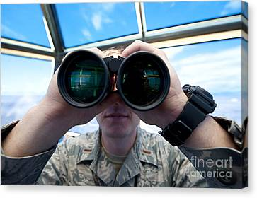 Lieutenant Uses Binoculars To Scan Canvas Print by Stocktrek Images